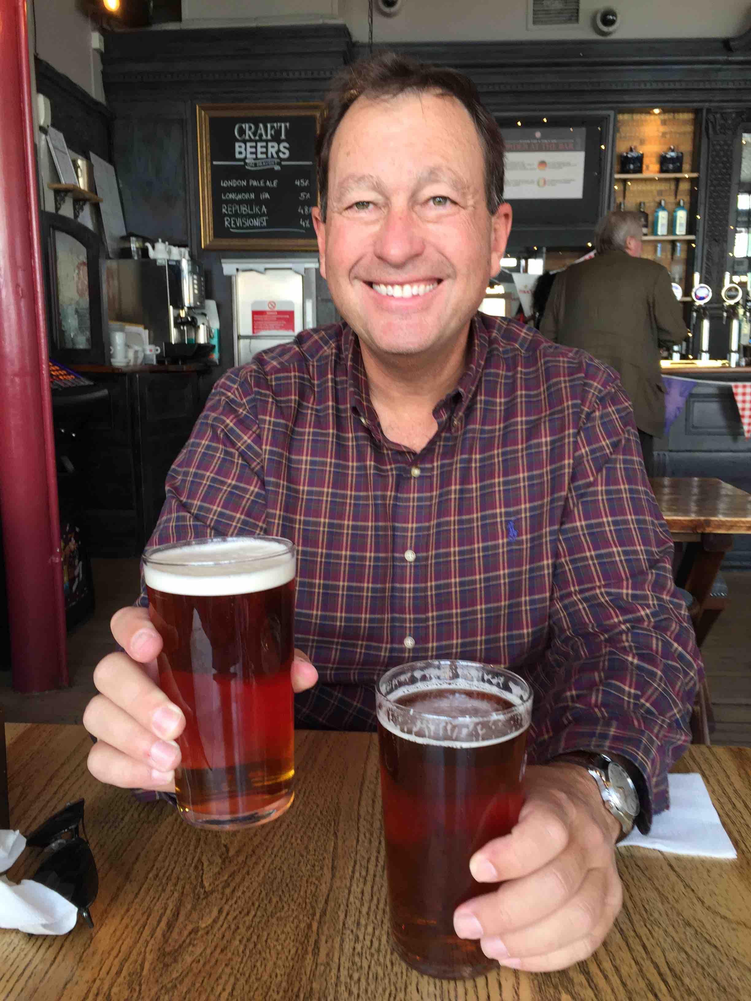 Eric Fuller having two pints of bitter