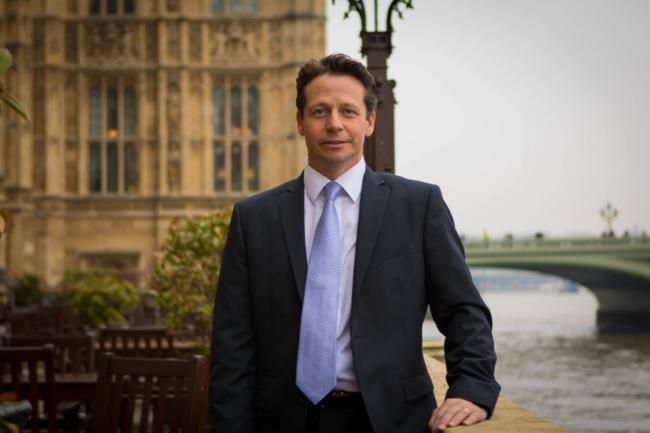 Nigel Huddleston in front of Parliament