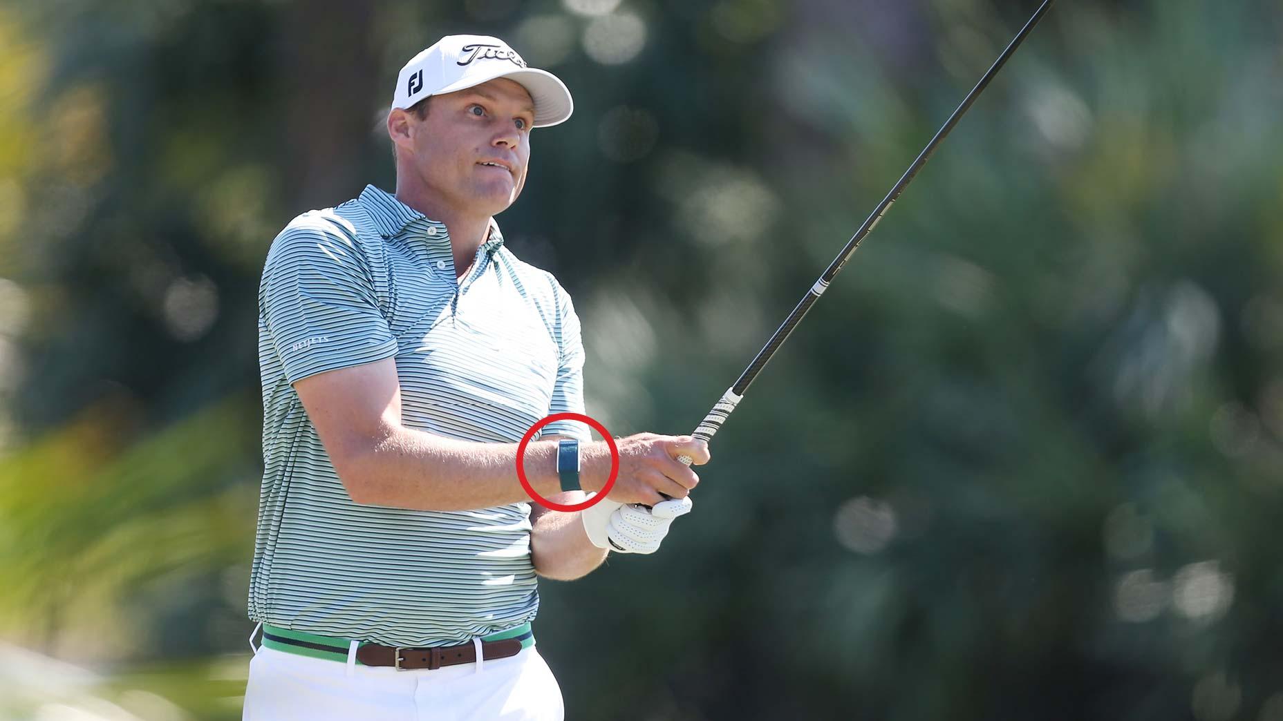 Nick Watney golfing wearing a Whoop wristband tracker