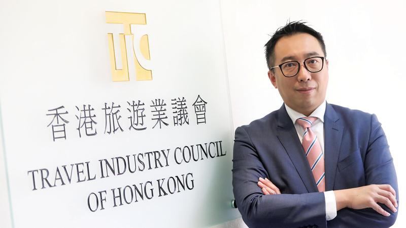 Jason Wong Chun-tat in fron of the Travel Industry Council of Hong Kong