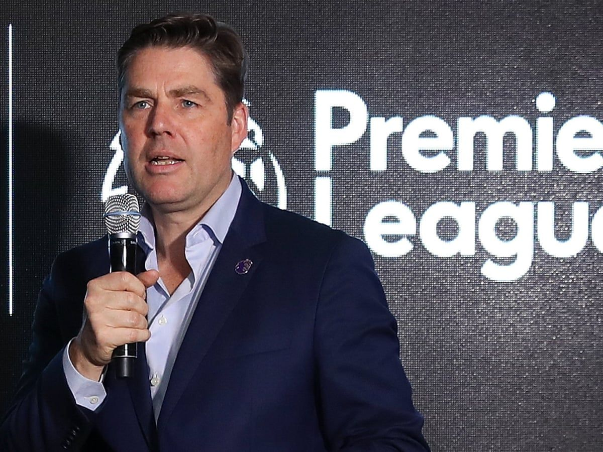 Richard Masters with microphone in front of Premier League logo