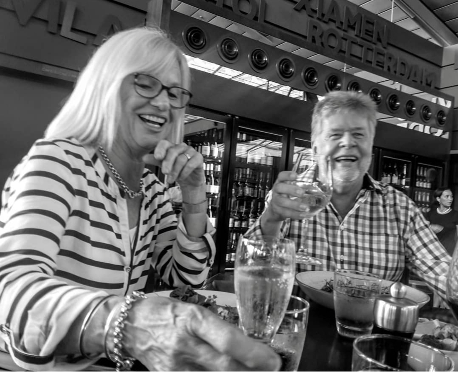 Ray Hume and wife Sharen having a laugh and a drink